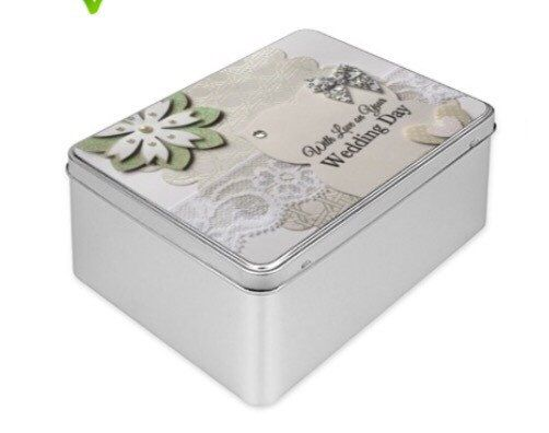A personal favourite from my Etsy shop https://www.etsy.com/listing/223405111/wedding-keepsake-memory-tin-box