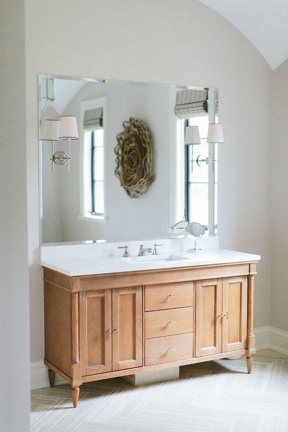 Bathroom Cabinet. White oak bathroom cabinet. White oak bathroom cabinet with marble countertop and herringbone tiles. White oak bathroom cabinet ideas. Whitewashed White oak bathroom cabinet. #Whiteoak #bathroom #cabinet #Whiteoakbathroomcabinet #bathroomcabinet Kate Marker Interiors.
