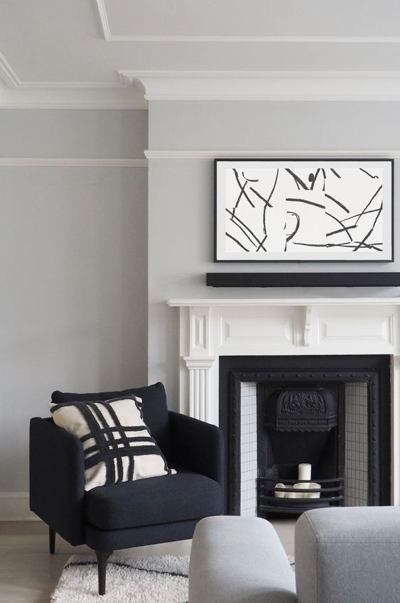 Minimalist living room with Samsung Frame TV disguised as artwork - Farrow & Ball Blackened walls, grey sofa, berber rug - Victorian renovation project - London renovation project - Victorian fireplace restoration