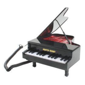 Telefono fijo como un Piano de cola | Badulaque Electrónico
