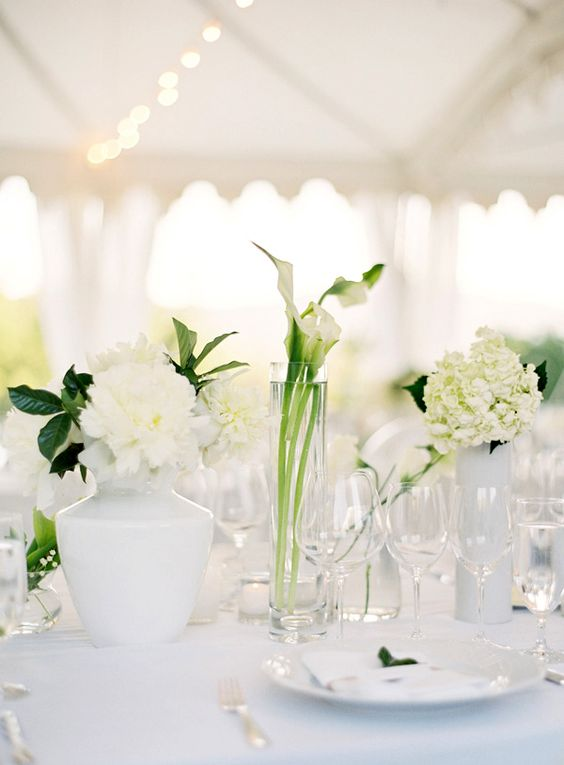 Monochromatic WHITE wedding flowers. Monochromatic bouquets and arrangements of wedding flowers are fantastic as they allow you to combine flower varieties or create like-variety flower arrangements.