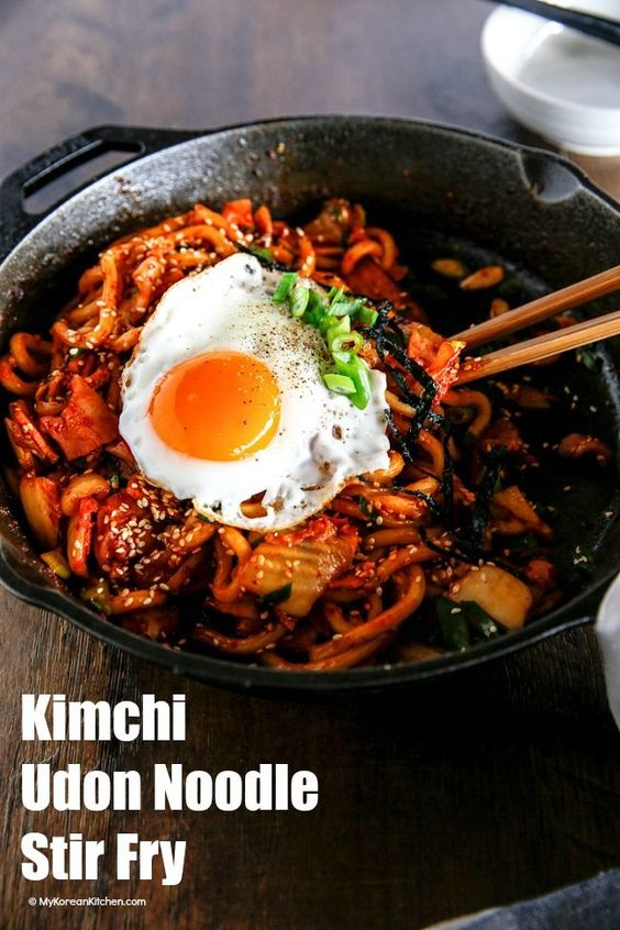 Kimchi udon noodle stir fry is an easy weeknight meal that can be ready in 15 mins. Key ingredients are bacon, Kimchi, udon noodles and Korean spicy sauce. It's simply addictive! It will be your new favourite noodle dish! | http://MyKoreanKitchen.com
