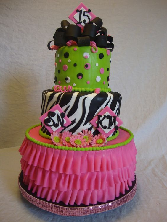 Zebra Ruffle - Southern Yellow Cake/ Chocolate-Chocolate Chip with French Vanilla Buttercream. The cake is covered with fondant and has gum paste accessories.