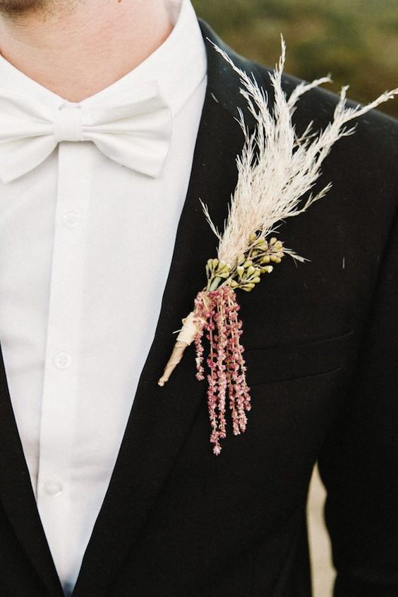 pampas grass wedding boutonniere and wedding suit | 13 Whimsical Ways to Use Pampas Grass in Your Wedding  #groom #groomsuit #weddings #suit #tuxedo #gentlemen #boutonniere #weddinggroom