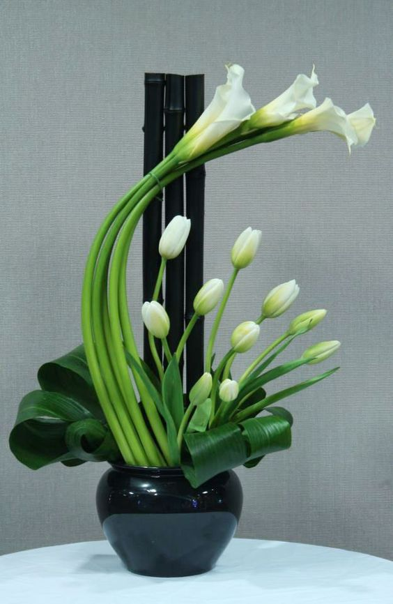 My Favorite Calli Lily's In A Very Modern Looking Floral Arrangement
