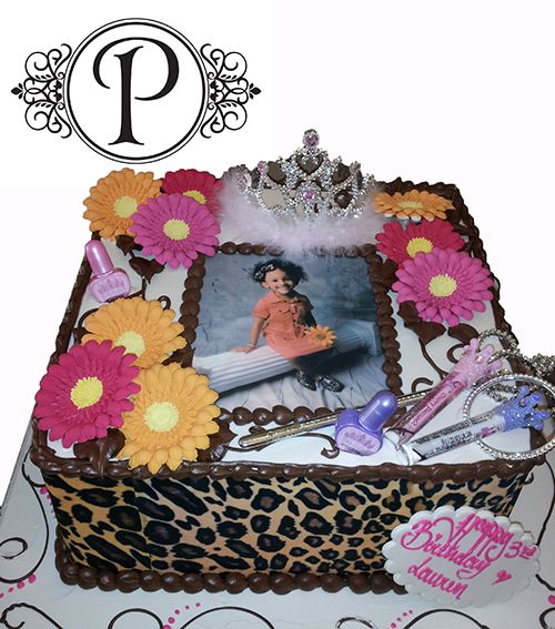 This princess theme specialty cake is well adorned with cheetah print, daisies, and an edible portrait!