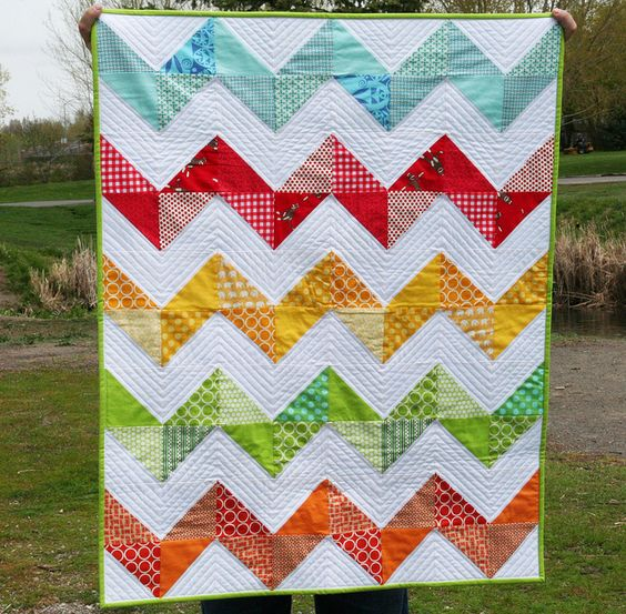 I feel like I have to do a quilt like this. So lovely and bright and cheerful!