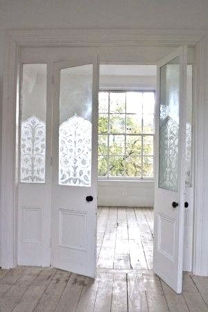 I like the idea of window decals on the front door and hallway window, rather than voiles (easier to keep clean and maintain).  Possibly damask to match wallpaper.