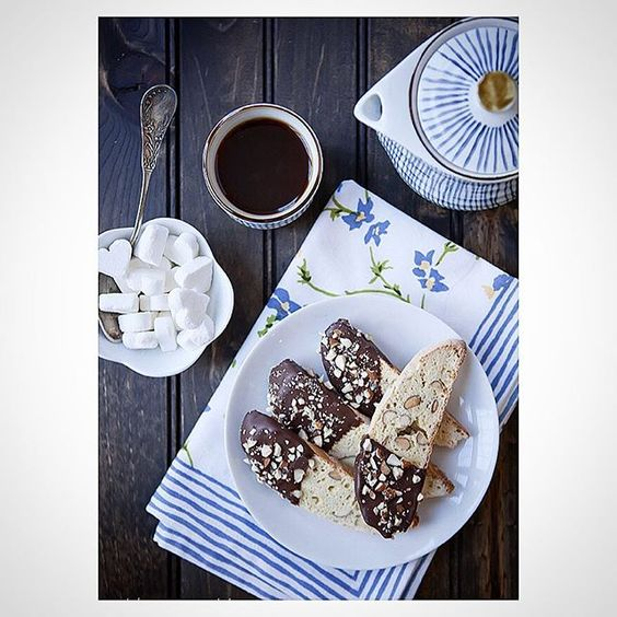 Homemade almond biscotti. Dip tips in melted chocolate and roll in chopped…