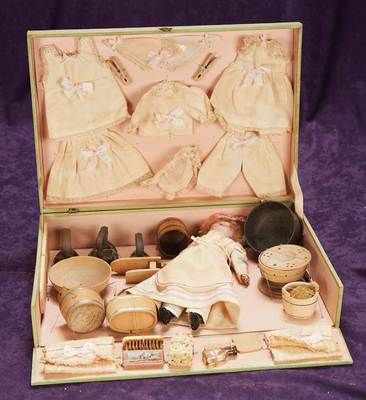 French 1890 Bisque head doll with glass eyes wearing laundress costume, assortment of lingerie (washed and ironed) Flat irons, Wooden scrub bowls and buckets, sponges, soap and sleeve ironing board.✷