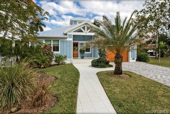 Key West Style House in Olde Naples, Florida. Blue, white trim ...