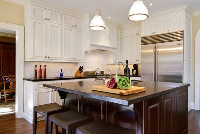 recessed panel cloud white kitchen with cherry island. Toronto.