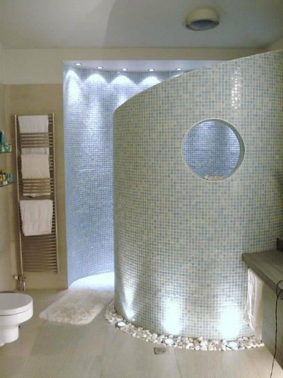 Curved walk in shower- no doors or curtains necessary.