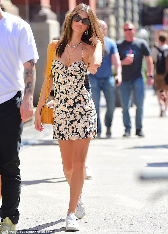 Daiseys: The 27-year-old flaunted her cleave and slender stems in a navy, floral mini dres...