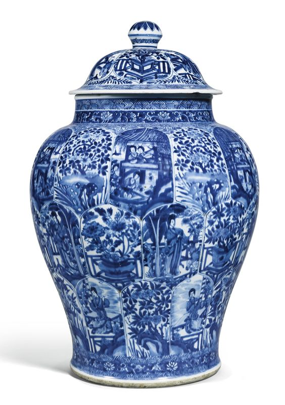 A BLUE AND WHITE 'LADIES' JAR AND COVER QING DYNASTY, KANGXI PERIOD Estimate: 12,000 - 15,000 GBP  the baluster body rising to a waisted neck with lipped rim, the body moulded and painted with three rows of petal-shaped panels variously enclosing blossoming flowers and ladies in a garden, all divided by geometric and floral bands, the cover similarly decorated Quantity: 2 56cm