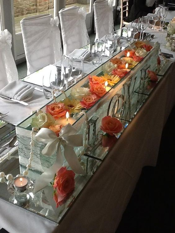 Our Top Table tanks make a welcome change from a full on flower display by T.J.