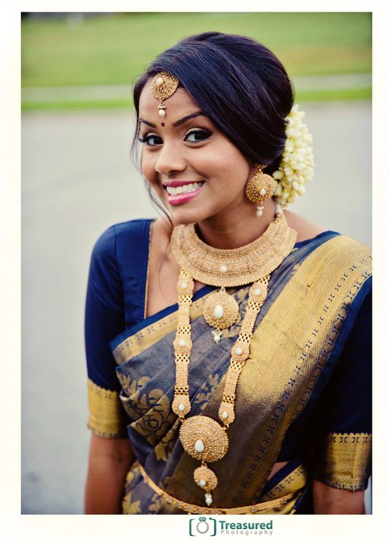 South Indian bride. Temple jewelry. Jhumkis.Navy blue silk kanchipuram sari.Braid with fresh jasmine flowers. Tamil bride. Telugu bride. Kannada bride. Hindu bride. Malayalee bride.Kerala bride.South Indian wedding
