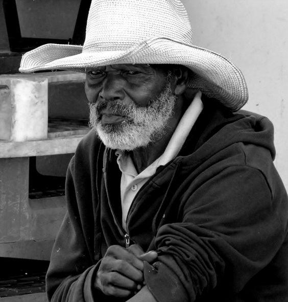 Loneliness - homeless man near the fishing dock Albufeira, Algarve