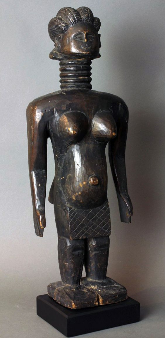 Africa | Statue from the Mende people of Sierra Leone | Wood; deep patina | 20th century