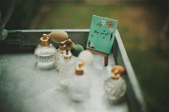 Bug repellant in vintage atomizers for your guests // photo by JonasPeterson.com