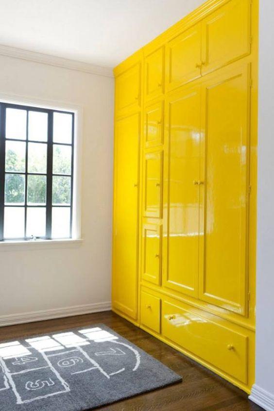 omg love the hi-gloss yellow wall of cabinets!!!