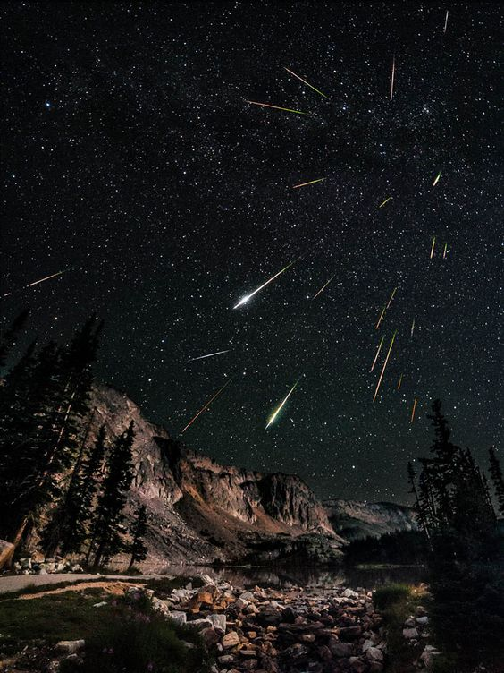"""Perseids meteor shower as observed from the Snowy Range in Wyoming  """"This is a composite of 23 images, 22 for the meteors/stars and 1 taken at sunrise for the foreground which was lightly blended in. I also corrected the orientation of the meteors to account for the rotation of the earth (this took forever!)"""""""