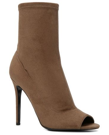 Eliliane boots by ALDO. Show off your pedi, even in booties. This sleek pair is stretchy and pulls on easily, for a seamless finish. - Slip-o...