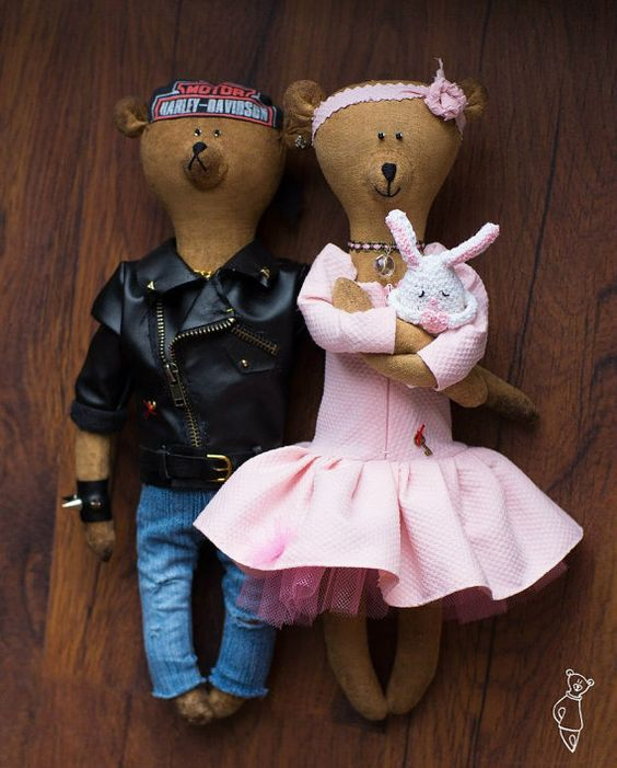 Brummi bear biker in a leather jacket and his gentle girl