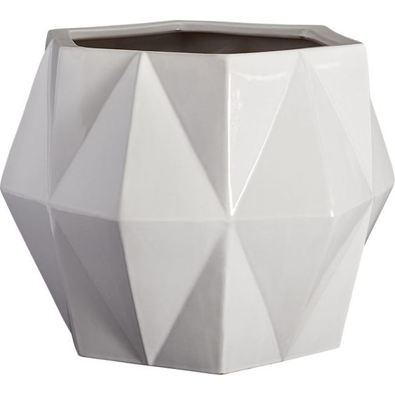Isla Planter | Handmade from eco-friendly clay, earthenware angles form diamond-like facets from rounded base to tapered top.