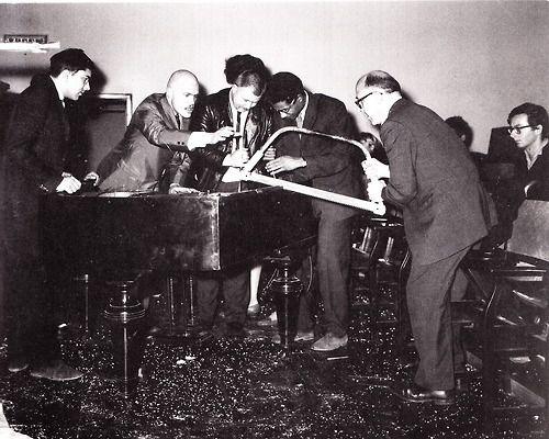 FLUXUS George Maciunas, Dick Higgins, Wolf Vostell, Benjamin Patterson, Emmett Williams performing Phillip Corner's Piano Activities at Fluxus Internationale Festspiele Neuester Musik, Wiesbaden (1962)