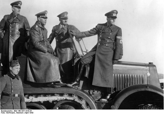 Keitel, Hitler, and Speer observing the field during a weapons demonstration, circa 6 Apr 1943.