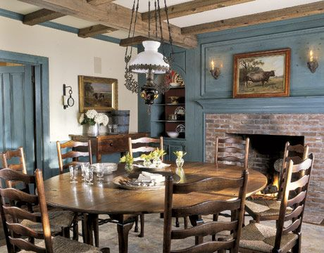 The dining room's cool, soothing blues and brick fireplace are very rustic chic.