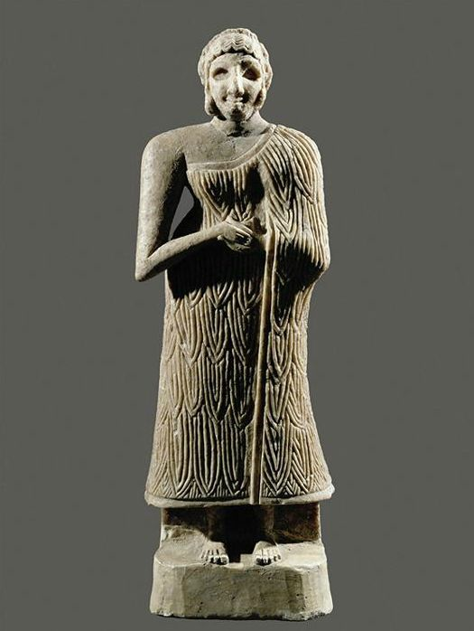 """""""Woman With Folded Hands"""" Mesopotamian, Sumerian, Early Dynastic c. 2650-2250 BCE woman wearing what both men and women wore, the Kaunakes garment in the form of a wrapped skirt. Her hair seems to be pulled into a Chignon held in place with a Fillet, and the date could possibly assume that she is wearing her hair confined in a net also."""