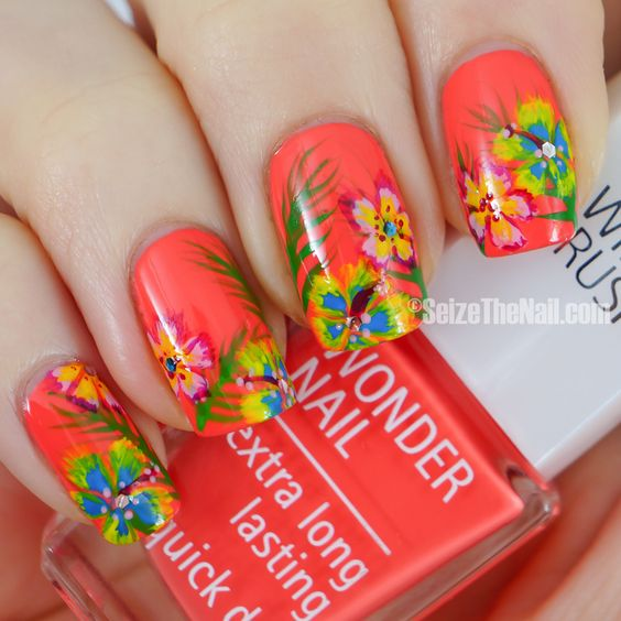 Tropical nails. Love the coral base colour!