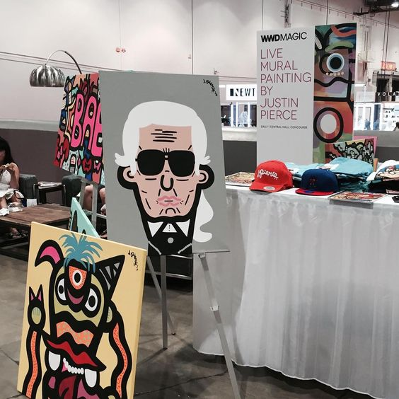 Love the live mural painting of Uncle @karllagerfeld at @magicmarketweek today. Art by Justin Pierce. |  #FSmagic #FSculture #magic #vegas #mural #karllagerfeld #unclekarl #chanel #tradeshow @wwd