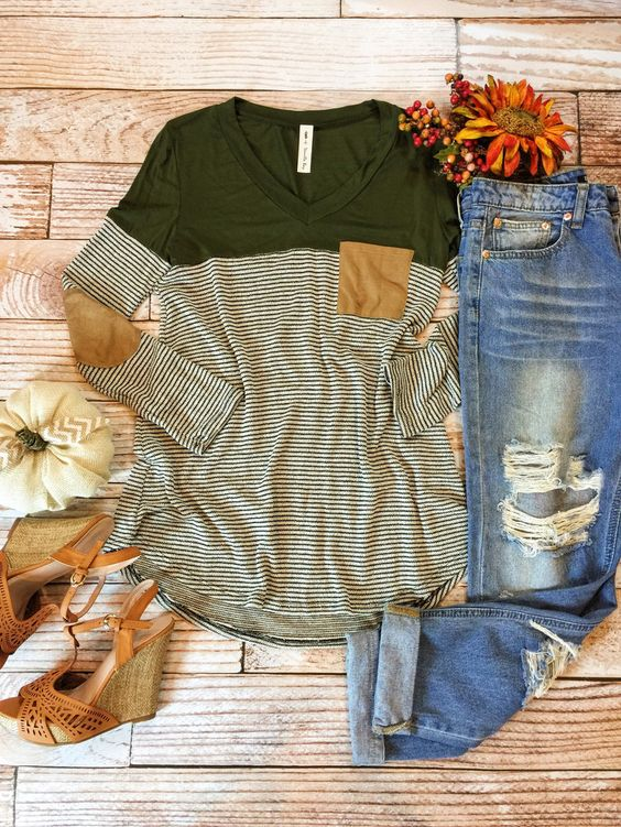 Green striped long sleeve tee with solid shoulders, brown suede contrast elbow patches and pocket, distressed boyfriend jeans, brown leather wedges