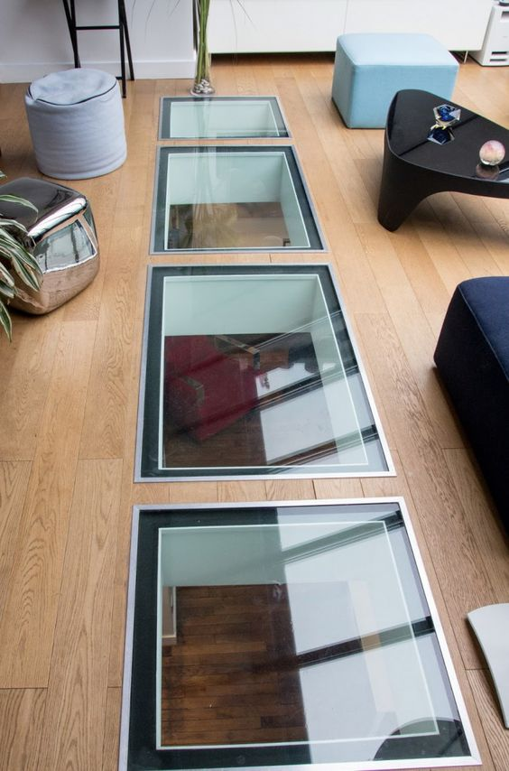 verri re de toit et puits de lumi re dans un duplex. Black Bedroom Furniture Sets. Home Design Ideas