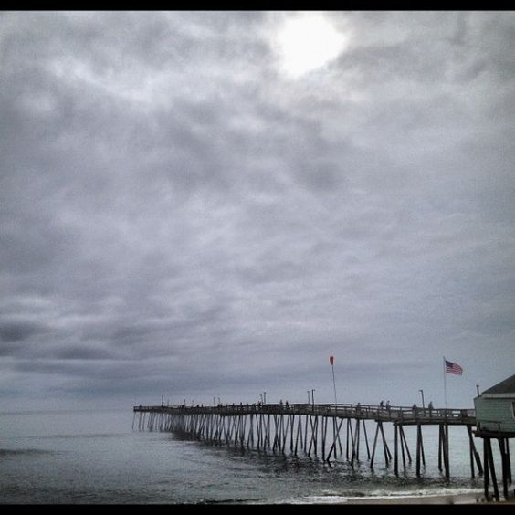 Sun & clouds, 70's NE breeze at Avalon Pier. Thunder boomers? No surf. Fish are biting.