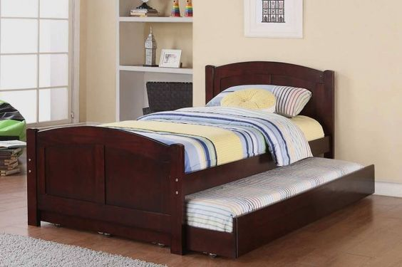 Trundle Bed Examples For Kid's Bedroom : Kids Room Idea With Trundle Beds Also Beige Wall Paint Color Along With Extra Bed Along With Wooden Floor Along With White Bookcase Design