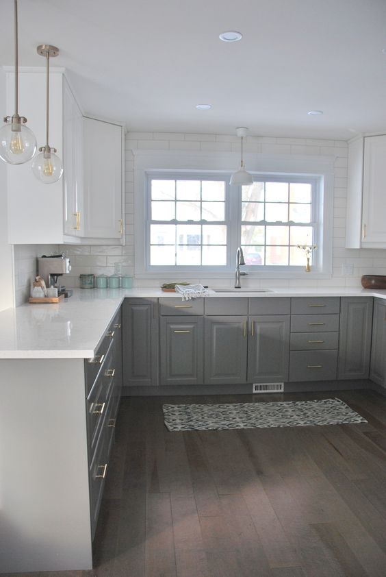 the colors of the lower cabinets and wood floor seem right. seems a little bland without black framed windows, other minor black details like trim on lighting, and other light oak wood accents in accessories - the white may be too white.... and  i may prefer the lower and upper cabinetry to be the same color: