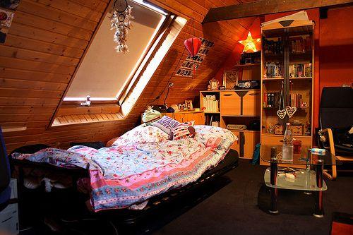 cool, wooden bedroom. that window on rainy days... genius!!
