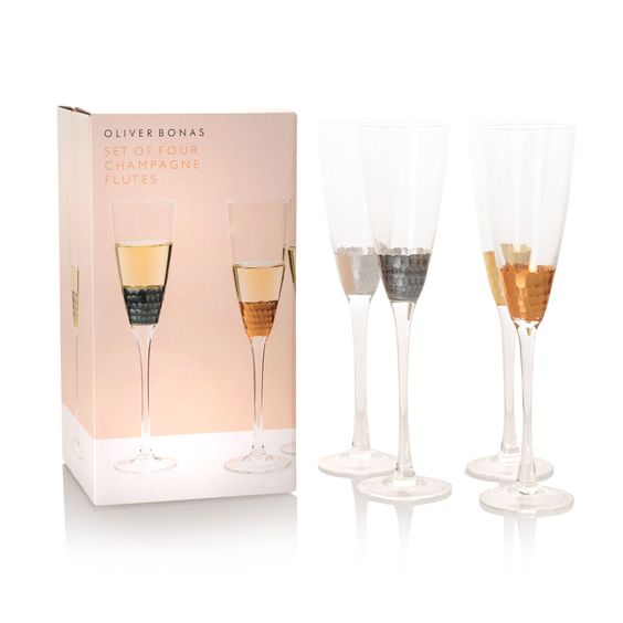 Buy the Set of Four Mixed Metallic Champagne Glasses at Oliver Bonas. Enjoy free UK standard delivery for orders over £50.