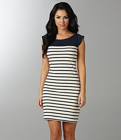 This dress with some chunky jewelry , big handbag and cute platform shoes.