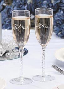 """Raise your glass and toast with these great Bride and Groom Twisted Stem Champagne glasses with double hearts on your special day!! Sold as a set - Bride and Groom. Approx.8"""" tall"""