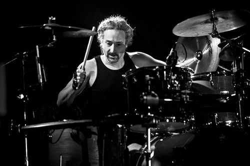 Mike Bordin, drummer from Faith no More is the guy I wanna be.  I'm considering learning to pay left handed so I can mimic his style precisely.