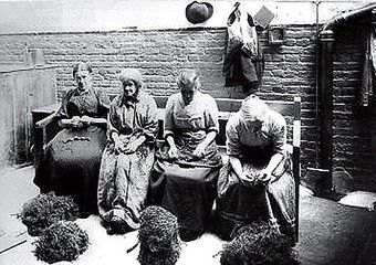 Poor women in the workhouse. Inmates would be given menial tasks as part of the Victorian ideal of salvation through work