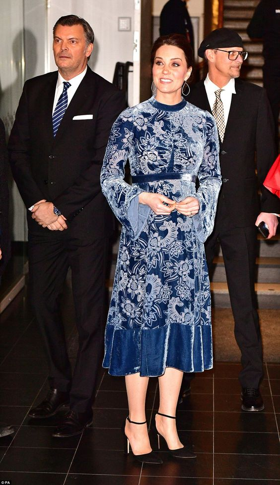 Kate opted for another floral number by Erdem, after sporting the same brand last night, pairing the blue velvet dress with black ankle strap heels