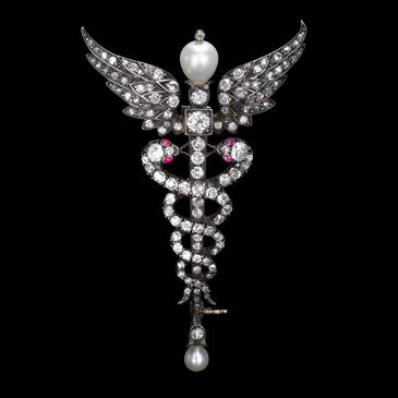 Natural pearl and diamond Caduceus brooch ca. 1900