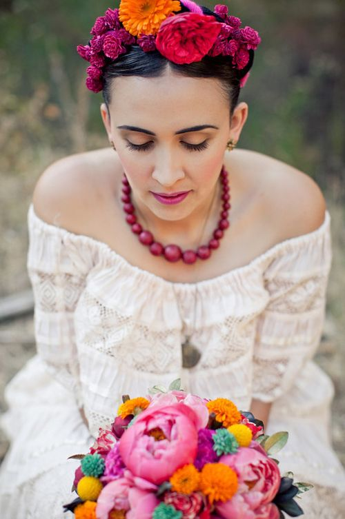 Bright colors and slight influences from major artist Frida Kahlo. We love the floral crown!