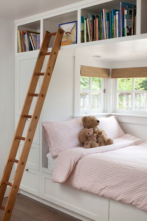 Nook bed with built-in bookshelves above.